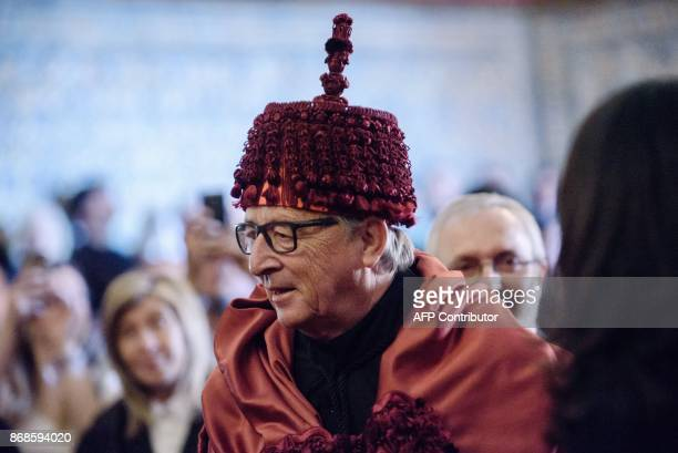European Commission president Jean Claude Juncker smiles after being awarded an Honoris Causa during a ceremony at the Sala dos Capelos at Coimbra...