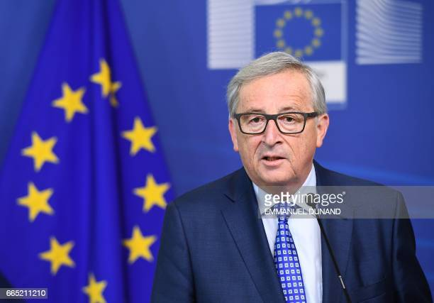 European Commission President JeanClaude Juncker addresses a press conference after meeting with Swiss President at the European Commission in...
