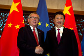 European Commission President JeanClaude Juncker and Chinese President Xi Jinping shake hands before a meeting held at the Diaoyutai State Guesthouse...