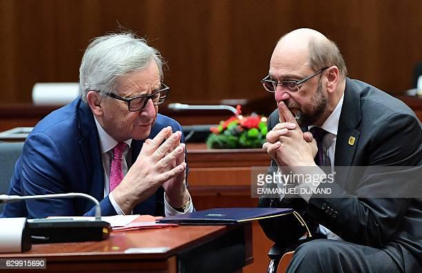 European Commission President JeanClaude Juncker and European Parliament President Martin Schulz speak toghether ahead of a European Union leaders...
