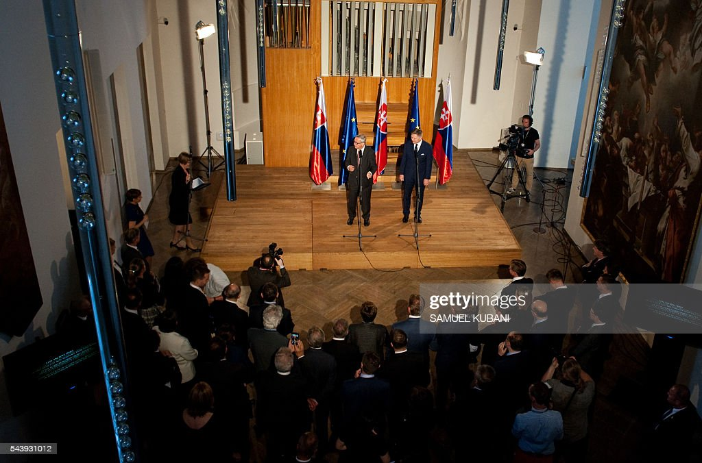 European Commission President Jean-Claude Juncker (L) and Slovak Prime Minister Robert Fico deliver a speech on June 30, 2016 in Bratislava. Netherlands hands over the rotating six-month Presidency of the Council of the European Union to Slovakia, which will take place the following day, 1 July. / AFP / SAMUEL
