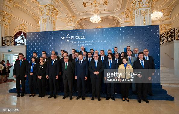 European Commission President JeanClaude Juncker and Slovak Prime Minister Robert Fico pose beside commissioners and slovak ministers during a visit...