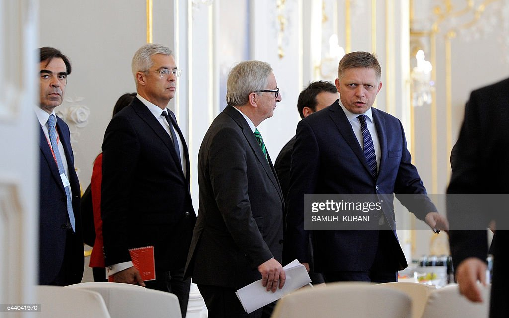 European Commission President Jean-Claude Juncker (C) and Slovak Prime Minister Robert Fico (C Right) arrive for a joint press conference, during a visit of the College of European Commissioners in Bratislava, on July 1, 2016. Slovakia assumes the rotating EU presidency. / AFP / SAMUEL