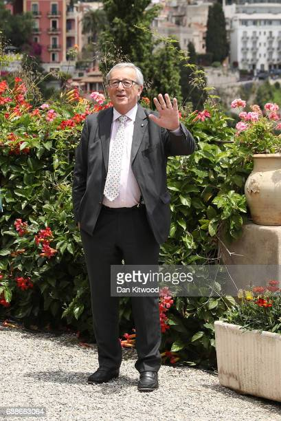 European Commission President JeanClaude Juncker attends a flypast at the San Domenico Palace Hotel on May 26 2017 in Taormina Italy US President...