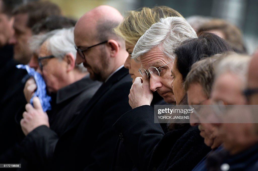 TOPSHOT European Commission President JeanClaude Juncker Belgian Prime Minister Charles Michel and King Philippe Filip of Belgium react before...