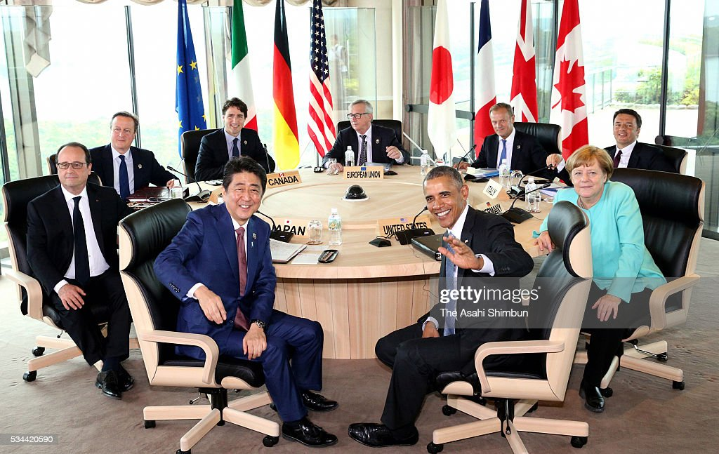 European Commission President Jean-Claude Juncker, Canadian Prime Minister Justin Trudeau, British Prime Minister David Cameron, French President Francois Hollande, Japanese Prime Minister Shinzo Abe, U.S. President Barack Obama, German Chancellor Angela Merkel, Italian Prime Minister Matteo Renzi and European Council President Donald Tusk pose for photographs at the working lunch during the Group of Seven summit on May 26, 2016 in Shima, Mie, Japan. The 2-day Group of Seven summit takes place to discuss key global issues such as global economy and counter terrorism measures.
