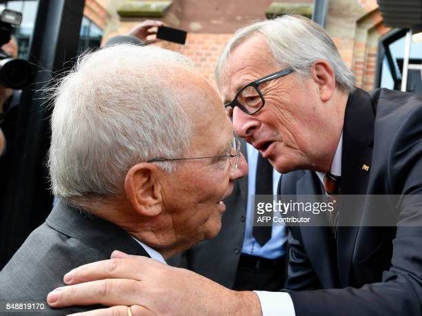 European Commission President JeanClaude Juncker congratulates German Finance Minister Wolfgang Schaeuble as he arrives for a reception to celebrate...