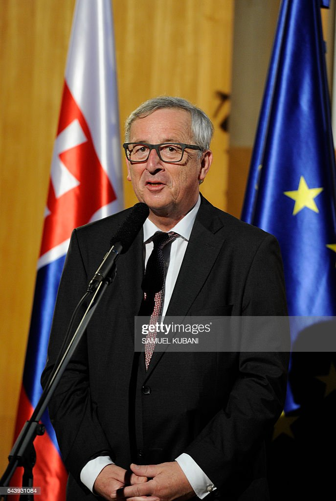 European Commission President Jean-Claude Juncker delivers his speech with Slovak Prime Minister on June 30, 2016 in Bratislava. Netherlands hands over the rotating six-month Presidency of the Council of the European Union to Slovakia, which will take place the following day, 1 July. / AFP / SAMUEL