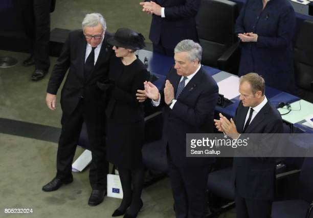European Commission President JeanClaude Juncker embraces Maike KohlRichter the widow of former German Chancellor Helmut Kohl as President oft he...
