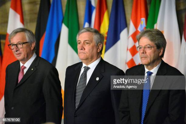 European Commission President JeanClaude Juncker European Parliament President Antonio Tajani and Italian Premier Paolo Gentiloni attend the EU's...