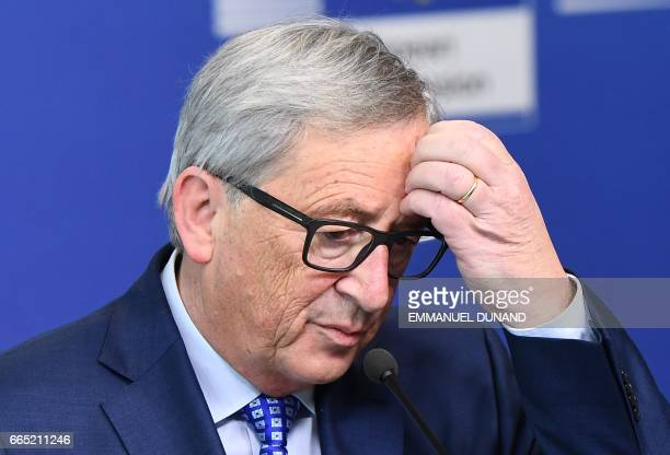 European Commission President JeanClaude Juncker gestures as he addresses a press conference after meeting with Swiss President at the European...