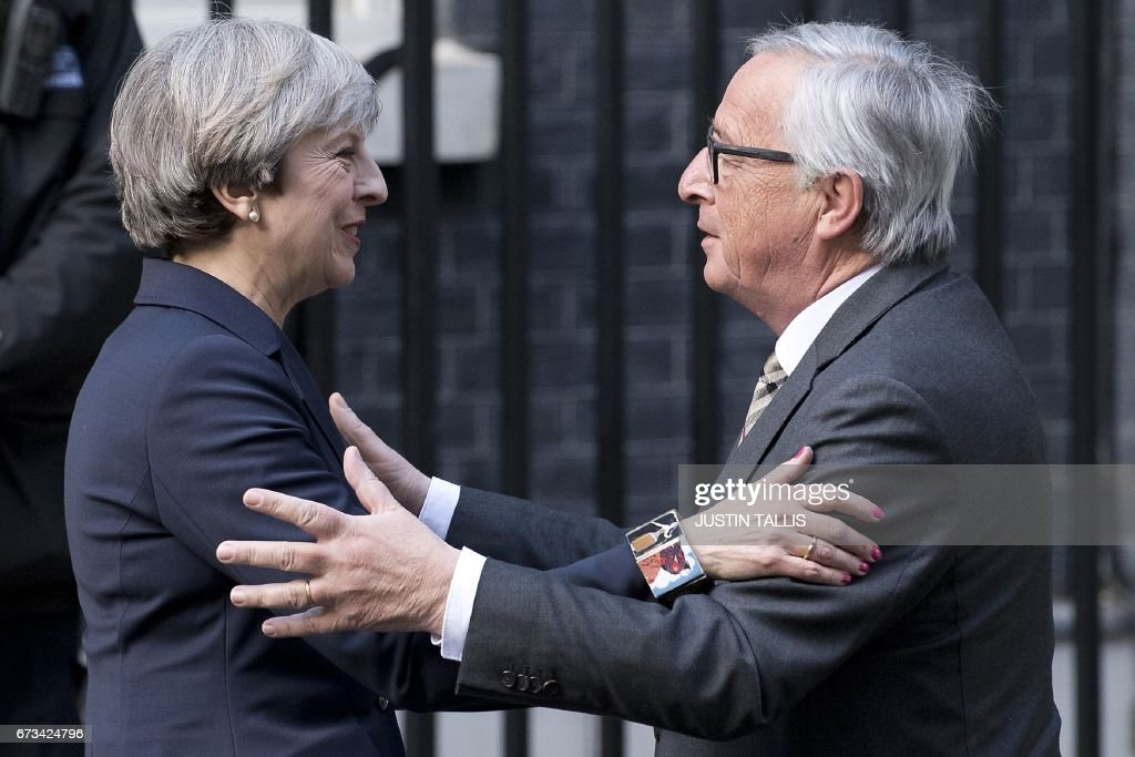 European Commission President, Jean-Claude Juncker (R) is greeted by British Prime Minister Theresa May outside 10 Downing Street in London on April 26, 2017. May hosts European Commission President Jean-Claude Juncker and chief negotiator Michel Barnier at Downing Street for the first face-to-face talks since she triggered the two-year process of withdrawing from the European Union. The encounter over dinner comes as the EU has toughened its strategy, making new demands over financial services, immigration and the bills Britain must settle before ending its 44-year-old membership in the bloc. PHOTO / Justin TALLIS