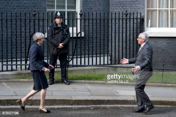 European Commission President JeanClaude Juncker is greeted by British Prime Minister Theresa May outside 10 Downing Street in London on April 26...