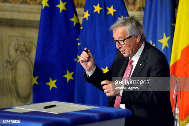 European Commission President JeanClaude Juncker poses for a photograph as he signs Rome declaration during the EU's 60th anniversary of the Treaty...