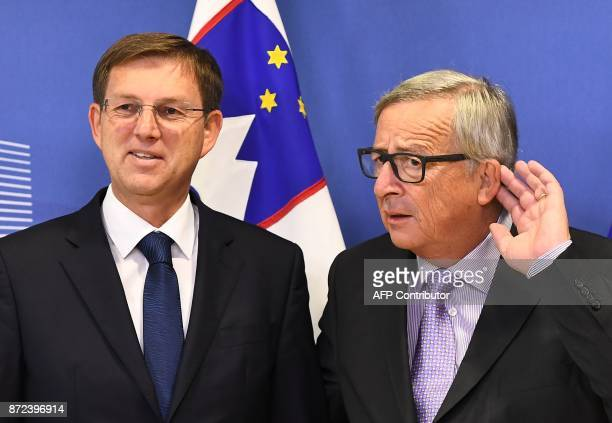 European Commission President JeanClaude Juncker reacts to a jounalist's question on Brexit while welcoming Slovenia's Prime Minister Miro Cerar at...