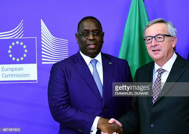 European Commission president JeanClaude Juncker shakes hands with Senegalese President Macky Sall upon his arrival for a meeting at the European...