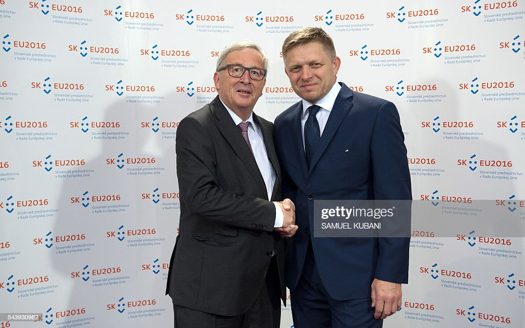 European Commission President Jean-Claude Juncker (L) shakes hands with Slovak Prime Minister Robert Fico during their meeting on June 30, 2016 in Bratislava. Netherlands hands over the rotating six-month Presidency of the Council of the European Union to Slovakia, which will take place the following day, 1 July. / AFP / SAMUEL
