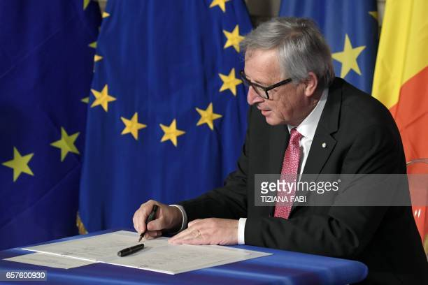 European Commission President JeanClaude Juncker signs the new Rome declaration with leaders of 27 European Union countries special during a summit...