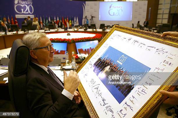 European Commission President JeanClaude Juncker signs the official G20 Leaders' Summit family photograph on day two of the G20 Turkey Leaders Summit...