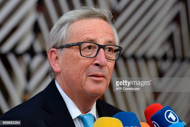 European Commission President JeanClaude Juncker speaks to media prior to an European Union leaders summit at the European Council in Brussels on...