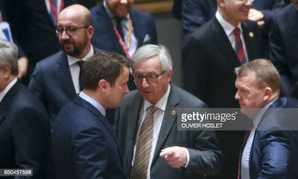European commission president JeanClaude Juncker talks with Prime Minister of Luxembourg Xavier Bettel next to Belgian Prime minister Charles Michel...