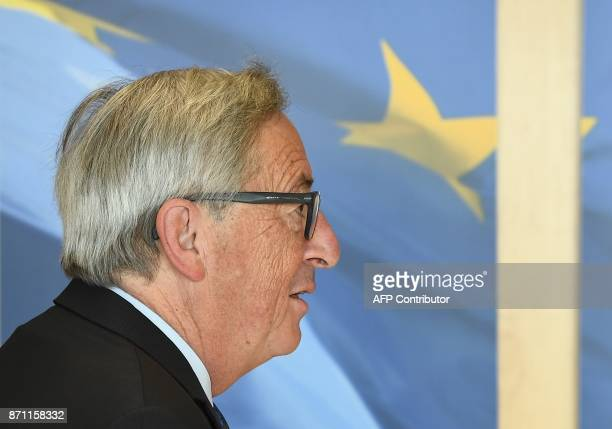 European Commission President JeanClaude Juncker welcomes Netherlands' Finance Minister at the European Commission in Brussels on November 7 2017 /...