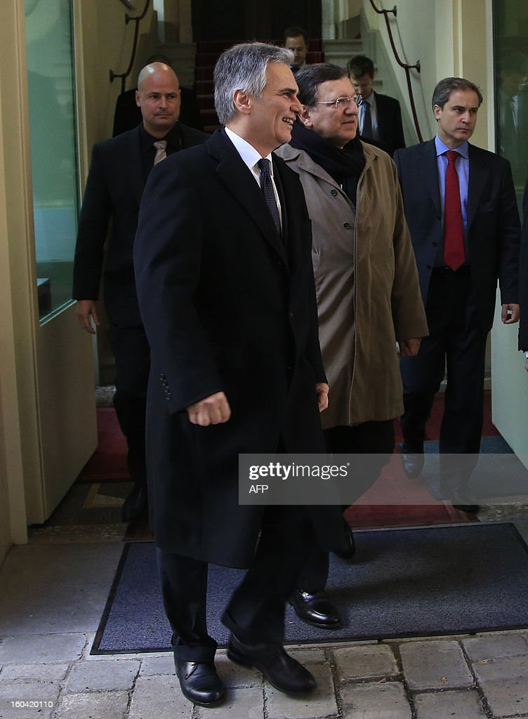 European Commission President Jose Manuel Barroso (2ndR) and Austrian Chancellor Werner Faymann (C) leave after a joint press conference in Vienna, Austria on January 31, 2013.