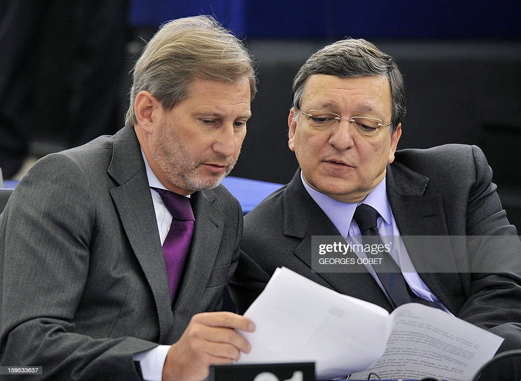 European Commission President Jose Manuel Barroso (R) and EU commissioner for Regional Policy Johannes Hahn (L) talk together prior to a debate on the future of European Union at the European Parliament in Strasbourg on January 15, 2013 during a plenary session.