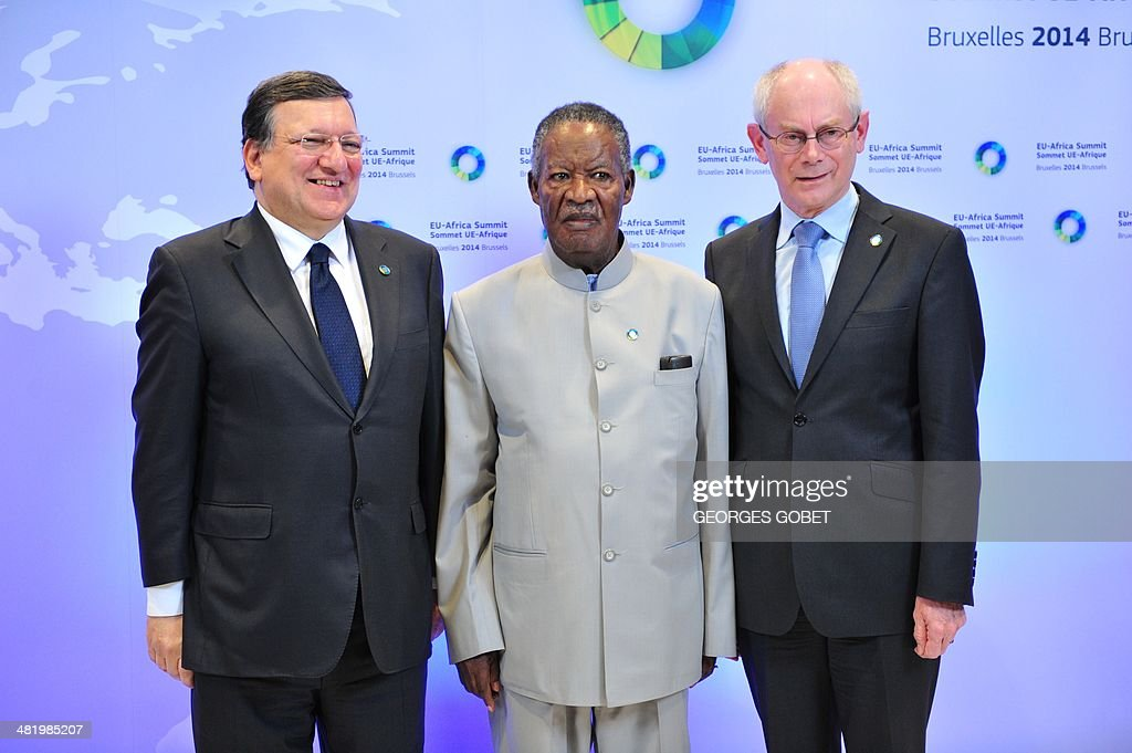 European Commission President Jose Manuel Barroso (L) and EU Council president Herman Van Rompuy (R) welcome Zambia's President Michael Chilufya Sata (C) prior to the 4th EU-Africa summit on April 2,2014 at the EU Headquarters in Brussels. African and European leaders opened crisis talks on the 'terrifying' violence in the Central African Republic where peacekeepers have been unable to stop a deadly spiral of Christian-Muslim strife.