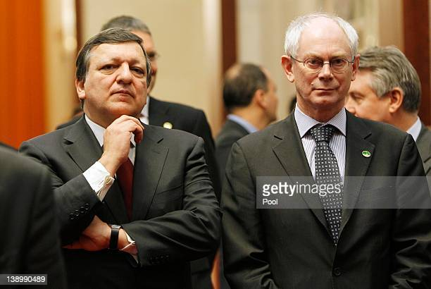 European Commission President Jose Manuel Barroso and European Council President Herman Van Rompuy wait in a corridor for their meeting with Chinese...