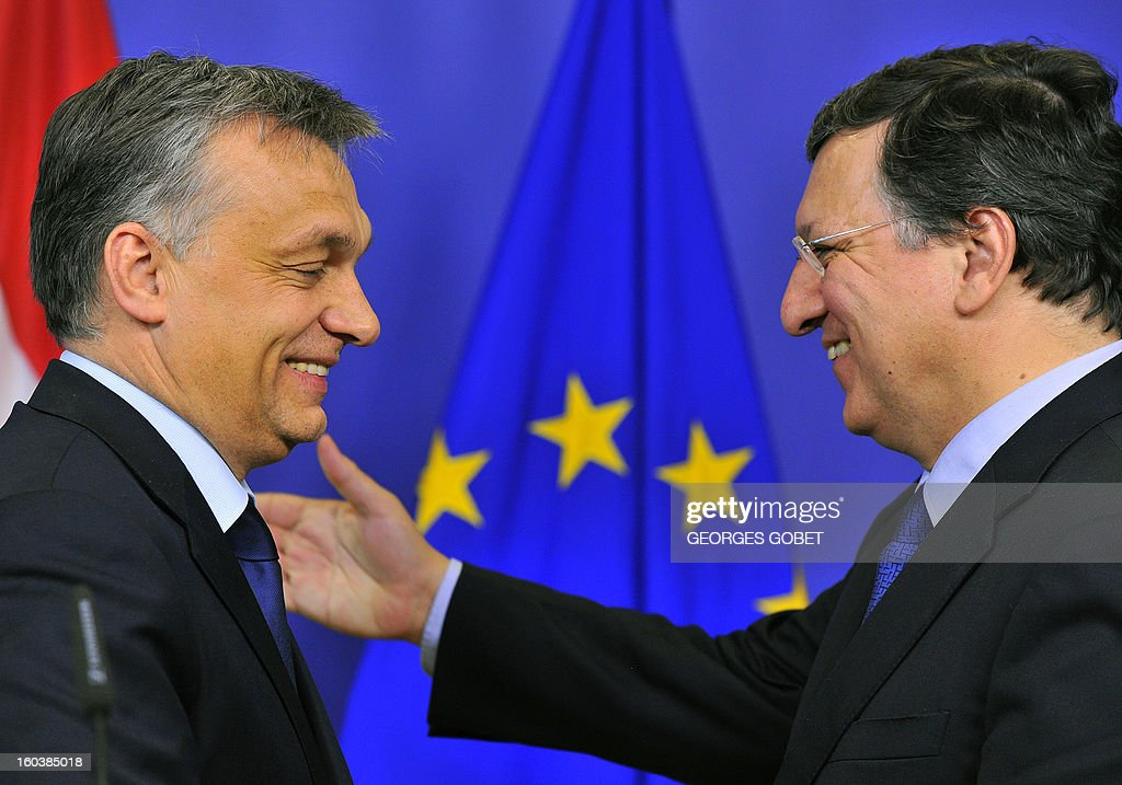 European Commission President Jose Manuel Barroso (R) and Hungary's Prime Minister Viktor Orban are pictured during a joint press conference following their working session on January 30, 2013 at the EU Headquarters in Brussels. AFP PHOTO GEORGES GOBET