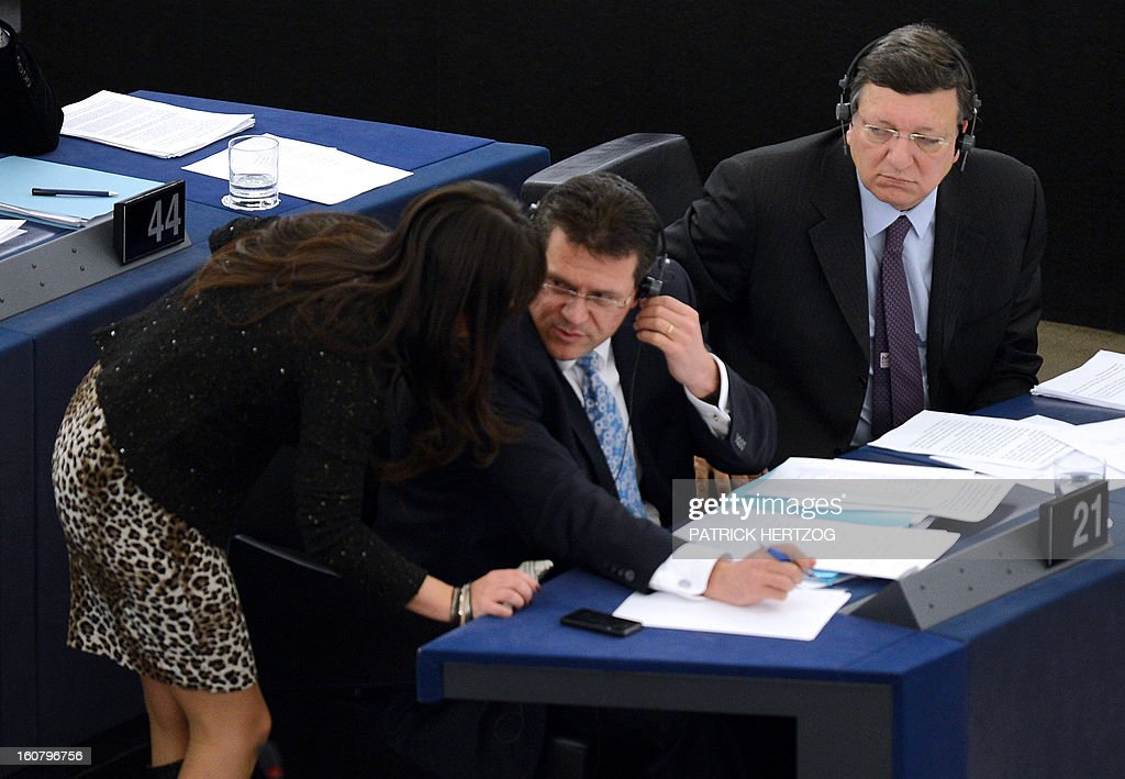 European Commission President Jose Manuel Barroso (R) attends a debate to prepare the next European Council meeting at the European Parliament in Strasbourg on February 6, 2013. The European Council meeting will be held on February 7 ot 8. AFP PHOTO PATRICK HERTZOG