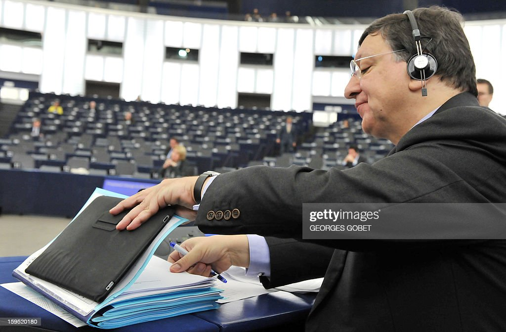 European Commission President Jose Manuel Barroso checks documents during the EP session at the European Parliament in Strasbourg, on January 15, 2013. The European Parliament will review Cyprus' Presidency of Council during the session.