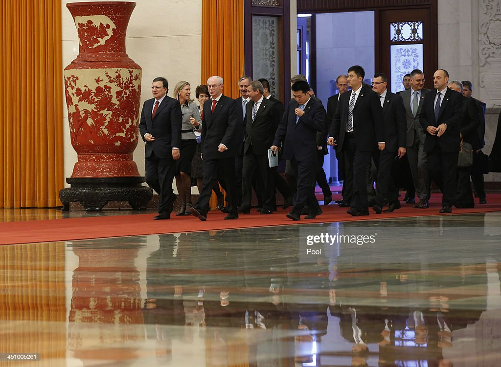 European Commission President Jose Manuel Barroso (L), European Council President Herman Van Rompuy (front, 2nd L) and their delegation arrive for meeting with China's Premier Li Keqiang at the Great Hall of the People, November 21, 2013 in Beijing, China.