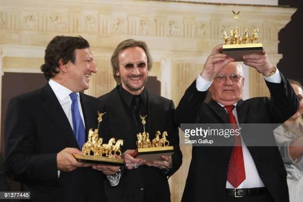 European Commission President Jose Manuel Barroso German singer Marius Mueller Westernhagen and former Soviet President Mikhail Gorbachev hold their...
