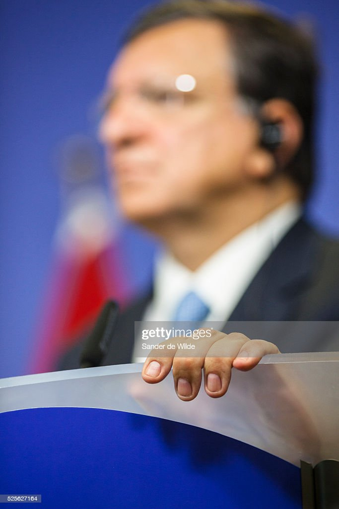 European Commission President Jose Manuel Barroso holds his finger on the stand prior to a meeting at the EU headquarters in Brussels with Egyptian...