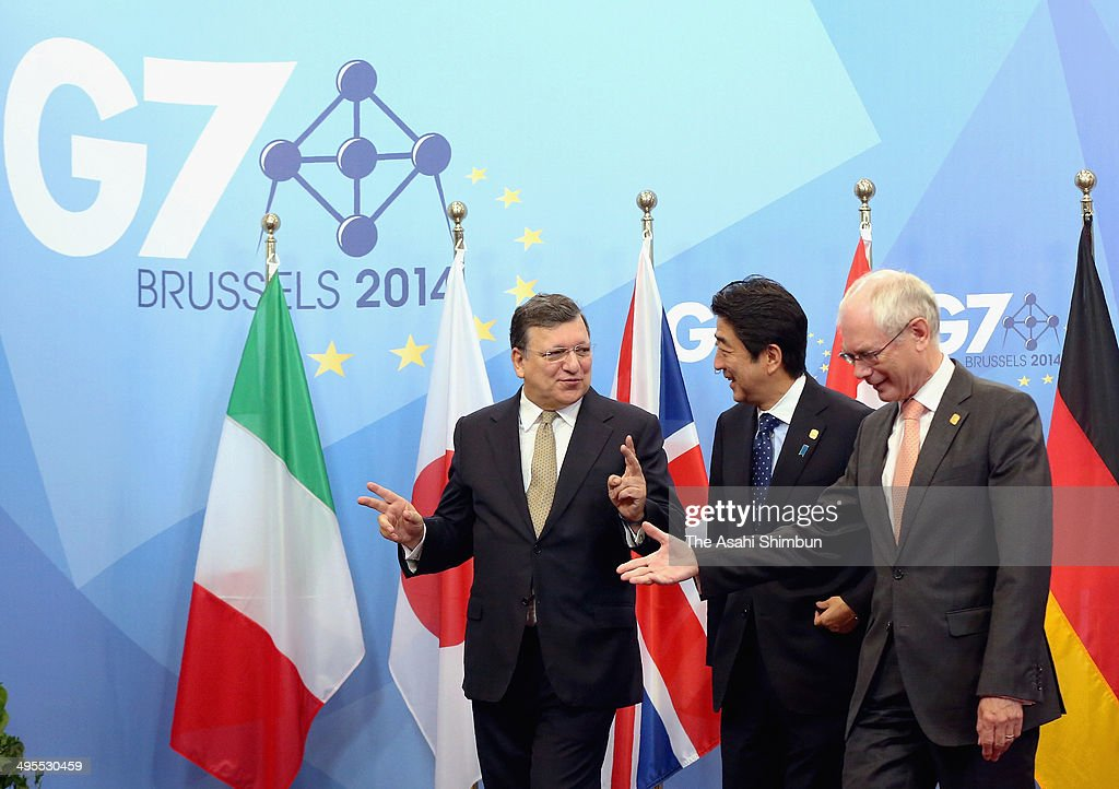 European Commission President Jose Manuel Barroso, Japanese Prime Minister Shinzo Abe and European Council President Herman van Rompuy pose for photographs prior to Japan-EU summit ahead of the G7 summit on June 4, 2014 in Brussels, Belgium.