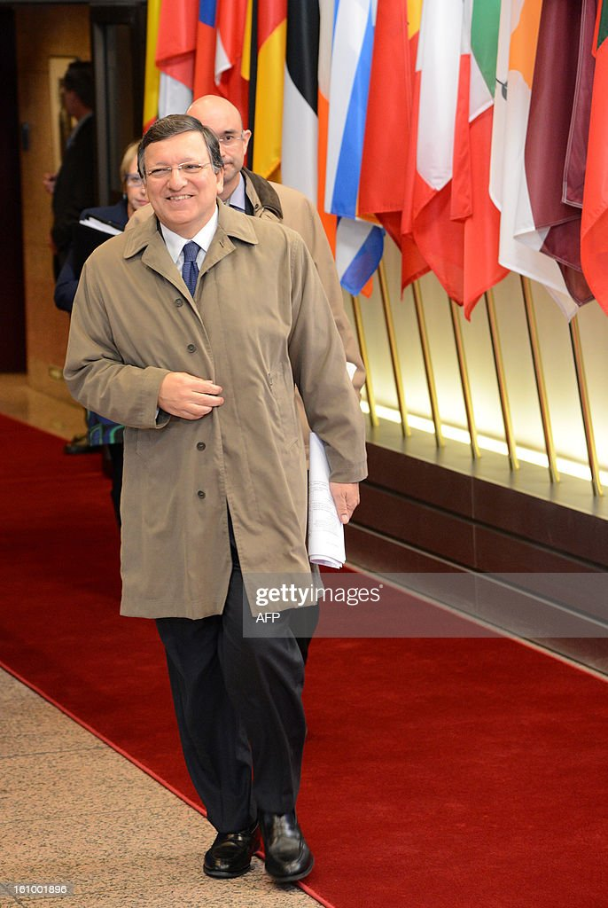 European Commission President Jose Manuel Barroso leaves the EU Headquarters on February 8, 2013 in Brussels, on the last day of a two-day European Union leaders summit. After 24 hours of talks lasting through the night, European Union leaders finally clinched a deal on the bloc's next 2014-2020 budget, summit chair and EU president Herman Van Rompuy said Friday.