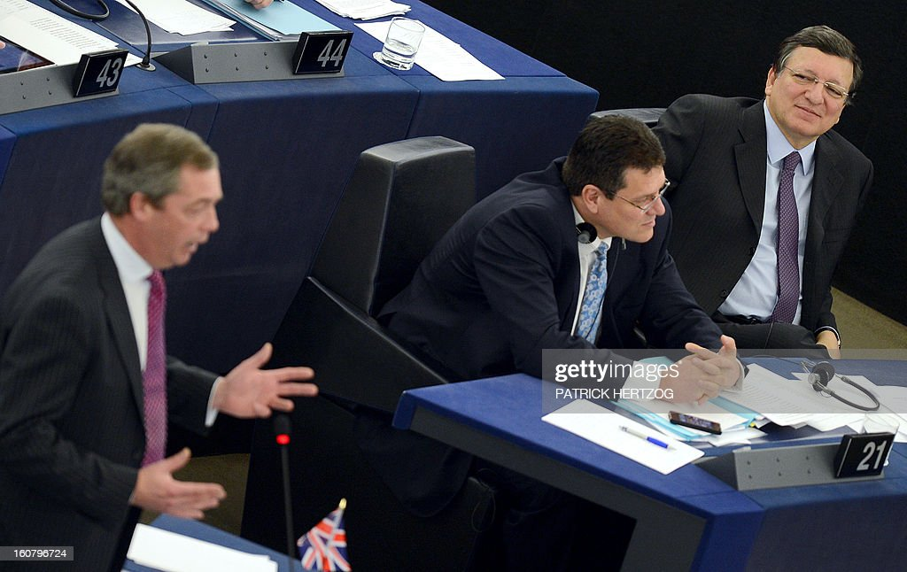 European Commission President Jose Manuel Barroso (R) looks at British Member of the European Parliament (MEP) Nigel Farage (L) as he delivers a speech during a debate to prepare the next European Council meeting at the European Parliament in Strasbourg on February 6, 2013. The European Council meeting will be held on February 7 ot 8. AFP PHOTO PATRICK HERTZOG