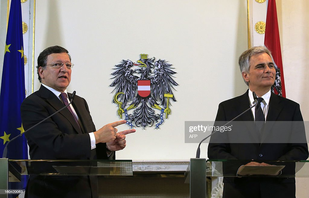 European Commission President Jose Manuel Barroso (L) points at Austrian Chancellor Werner Faymann (R) as they attend a joint press conference in Vienna, Austria on January 31, 2013. Barroso is also scheduled to speak at Arnold Schwarzenegger's environmental movement R20 holds its first conference.