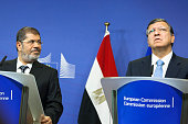 European Commission President Jose Manuel Barroso right and the Egyptian President Mohamed Morsi speak to the press prior to a meeting at the EU...