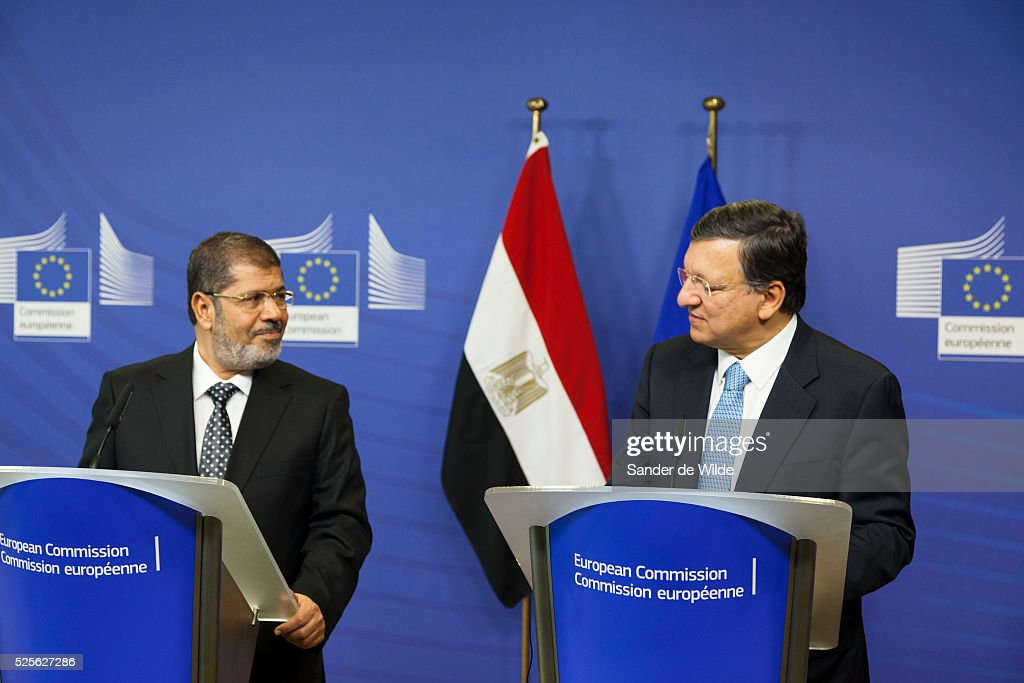 European Commission President Jose Manuel Barroso right greets Egyptian President Mohamed Morsi prior to a meeting at the EU headquarters in Brussels...