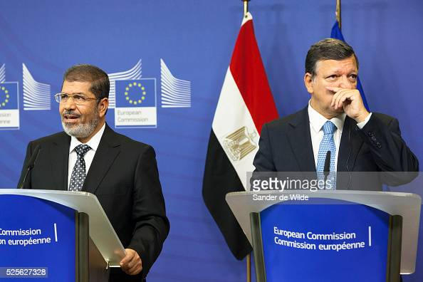 European Commission President Jose Manuel Barroso righttouching his nose and the Egyptian President Mohamed Morsi speak to the press prior to a...