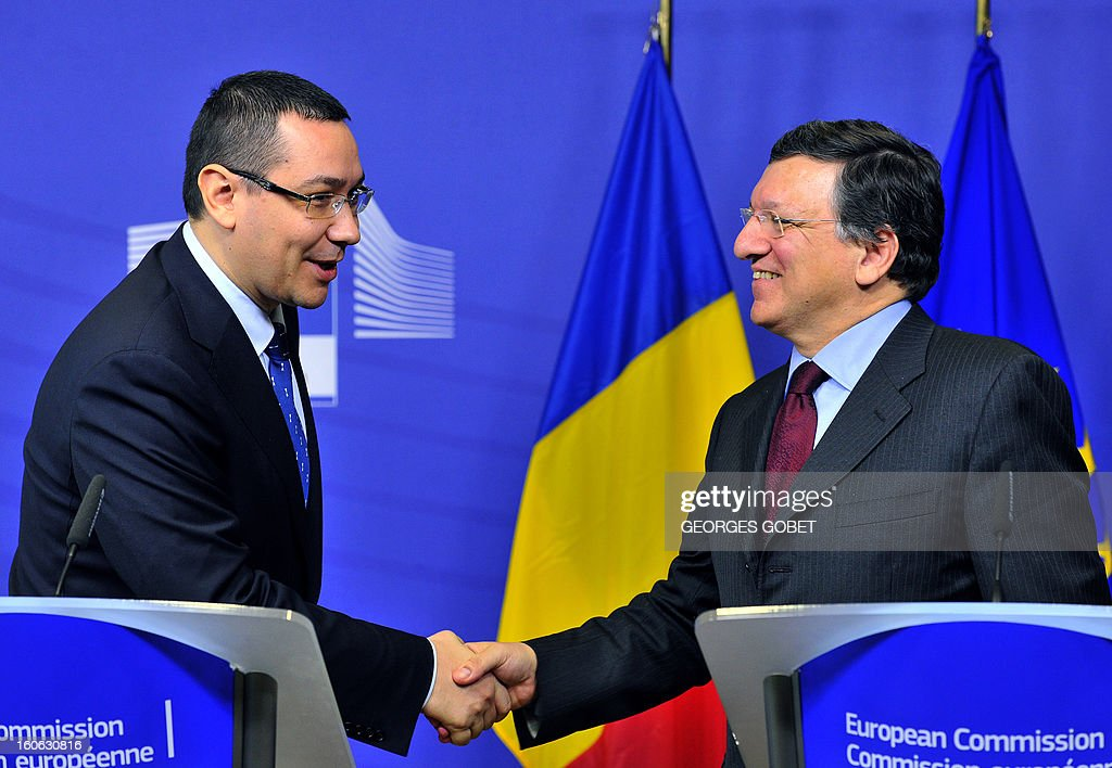 European Commission President Jose Manuel Barroso (R) shakes hands with Romanian Prime Minister Victor Ponta during a joint press conference after their working session on Feburary 4, 2013 at the EU Headquarters in Brussels.