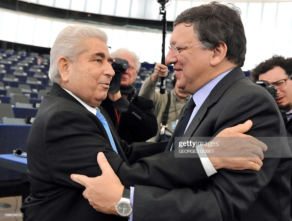 European Commission President Jose Manuel Barroso (R) welcomes Cypriot President Demetris Christofias (L) on January 15, 2013 at the European Parliament in Strasbourg. The European Parliament will review Cyprus' Presidency of Council.