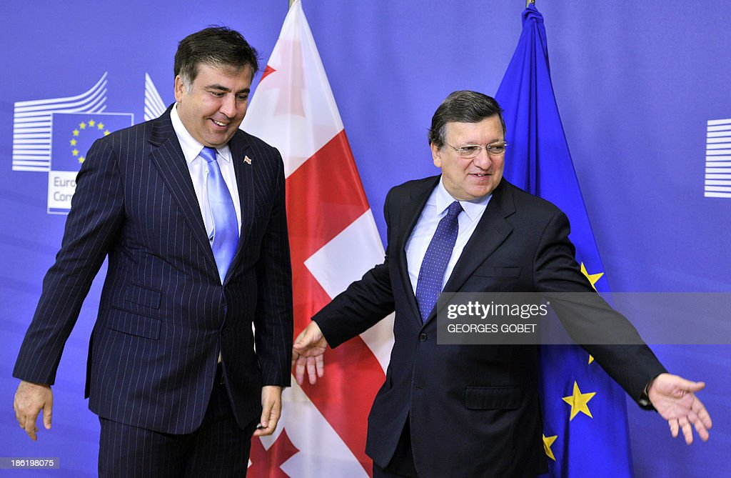 European Commission President Jose Manuel Barroso (R) welcomes President of Georgia Mikheil Sakashvili (L) on October 29,2013 prior to their working session at the EU Headquarters in Brussels.