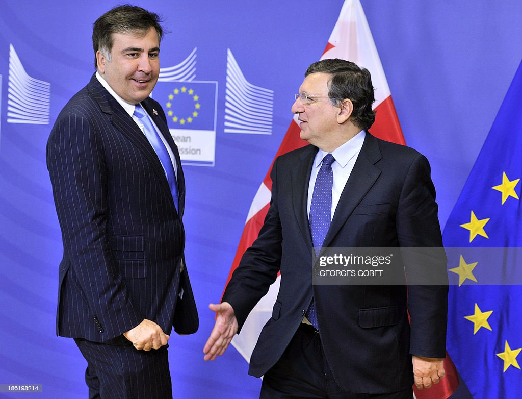 European Commission President Jose Manuel Barroso (R) welcomes President of Georgia Mikheil Sakashvili (L) on October 29,2013 prior to their working session at the EU Headquarters in Brussels. AFP PHOTO GEORGES GOBET