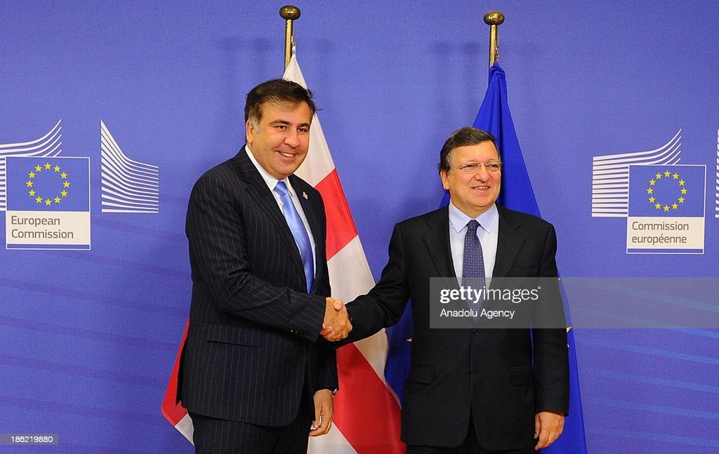 European Commission President Jose Manuel Barroso (R) welcomes President of Georgia Mikheil Saakashvili (L) prior to a meeting a meeting at the EU headquarters on October 29, 2013 in Brussels, Belgium.