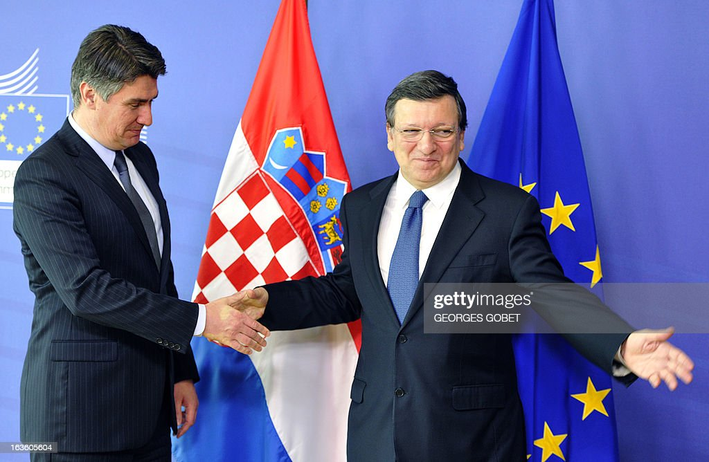 European Commission President Jose Manuel Barroso (R) welcomes Prime Minister of Croatia Zoran Milanovic prior to their working session on March 13 , 2013 at the EU Headquarters in Brussels.