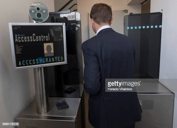 European Commission VicePresident Jyrki Katainen in charge of Jobs Growth Investment and Competitiveness goes through the first access control devise...